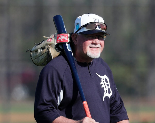 Detroit Tigers manager Ron Gardenhire walks onto the field at baseball spring training camp, Friday, Feb. 16, 2018, in Lakeland, Fla. (AP Photo/Lynne