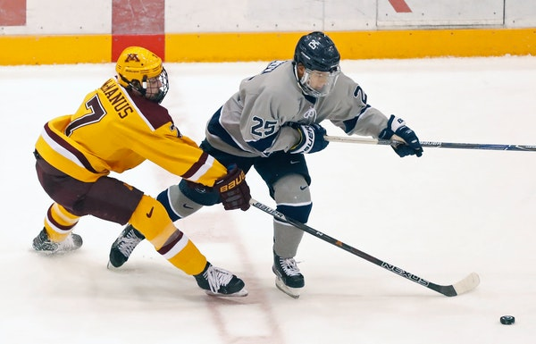 Brannon McMannus battles with Denis Smirnov during a Gophers vs. Penn State men's hockey game earlier this season. The Nittaly Lions won 5-1 on Friday