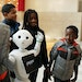 Josiah Adjei, 6, right, took a closer look at Pepper the robot during a family trip to the Mall of America. The robot acts as a guide for visitors.