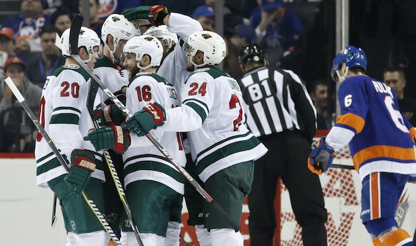 Wild players celebrate with Jason Zucker (16) after he scored a second-period goal Monday.