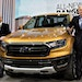 Jim Hackett, president and chief executive officer of Ford (right) and Bill Ford, executive chairman of Ford (left) stand next to a 2019 Ranger.