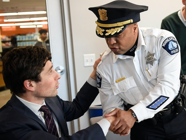 Minneapolis Mayor Jacob Frey shook hands with Minneapolis Police Chief Medaria Arradondo at the conclusion of a police-community relations round table