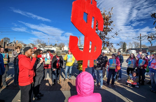 Supporters of the $15 minimum wage for St. Paul rallied in front of Walmart in the Midway area of St. Paul in November.