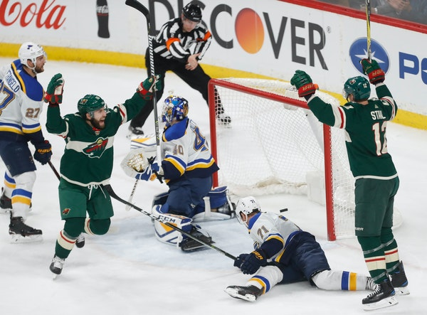 Jason Zucker (16) and Eric Staal (12) celebrate the Wild's fourth goal Tuesday at Xcel Energy Center.