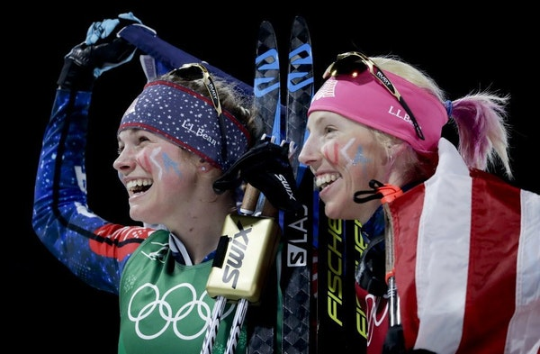 United States' Jessie Diggins, left, and Kikkan Randall celebrate after winning the gold medal in the women's team sprint freestyle cross-country skii