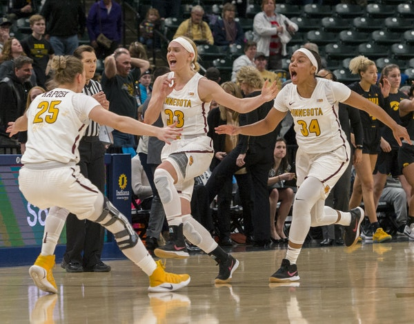 From left to right, Palma Kaposi, Carlie Wagner, Gadiva Hubbard and Kenisha Bell celebrated after beating Iowa 90-89 Friday in the Big Ten tournament.