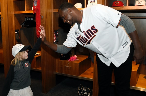 Minnesota Twins' Michael Pineda greets a young fan during the baseball team's TwinsFest on Friday, Jan. 19, 2018 in Minneapolis. (AP Photo/Hannah Fosl