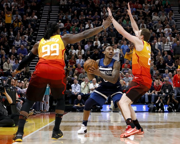 The Jazz's Jae Crowder (99) and Joe Ingles defended as Timberwolves guard Jeff Teague looked to pass during the first half Friday.