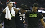 Timberwolves guard Jimmy Butler (23) needed help to get off the floor Friday in Houston.