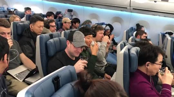 An in-flight toast to curling gold medal winners