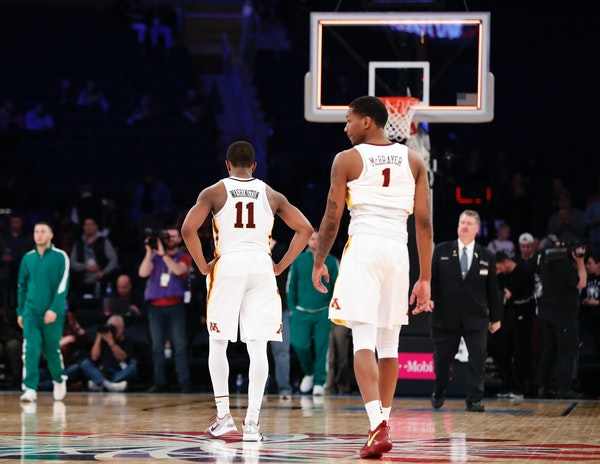 Minnesota guards Isaiah Washington (11) and Dupree McBrayer (1) walk off the court after the team's NCAA college basketball game against Rutgers in th