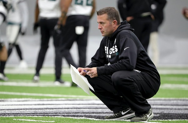 In this Jan. 3, 2018, photo, John DeFilippo watches the Eagles practice in Philadelphia. The Vikings hired DeFilippo as their offensive coordinator ea