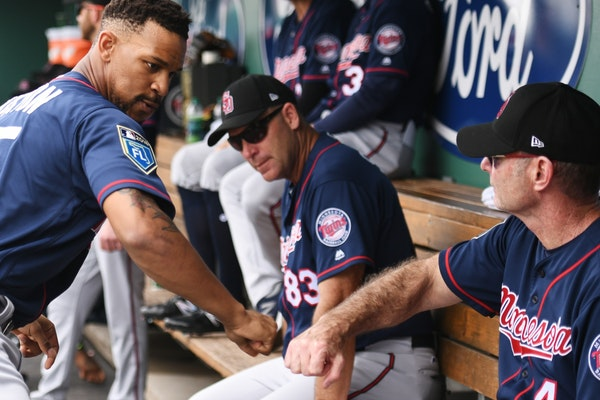 Twins outfielder Byron Buxton (25) fist bumped Twins manager Paul Molitor. During spring training, road teams are expected to field lineups with at le
