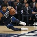 Timberwolves guard Derrick Rose lost his footing during the first half against Golden State at Target Center on Sunday.
