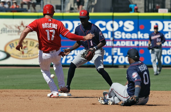 The Phillies' Rhys Hoskins was safe at second base as Twins second baseman Erick Aybar made an error on a relay throw to shortstop Nick Gordon during