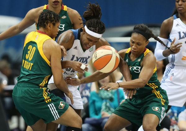 Tanisha Wright, left, played for Seattle against Lynx forward Rebekkah Brunson in a 2013 game at Target Center.