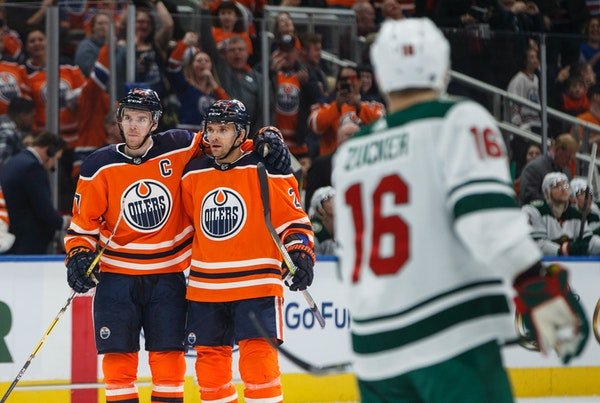 Edmonton Oilers center Connor McDavid (97) and defenseman Andrej Sekera (2) celebrate a goal against the Minnesota Wild during the second period of an