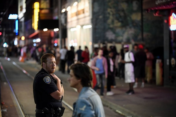 A Minneapolis police officer was watching out for trouble after bar closing time along 5th Street near Hennepin Avenue.