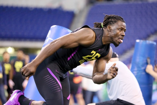 Tulane defensive lineman Ade Aruna performed in a drill at the NFL scouting combine in Indianapolis on Sunday.