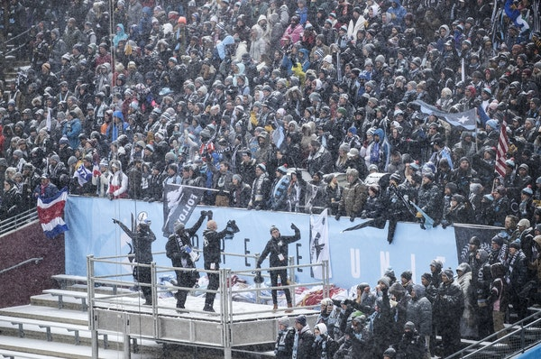 A snowy first: Minnesota United super fans, Dark Clouds and True North Elite members, packed into the supporters section behind the goal for the home