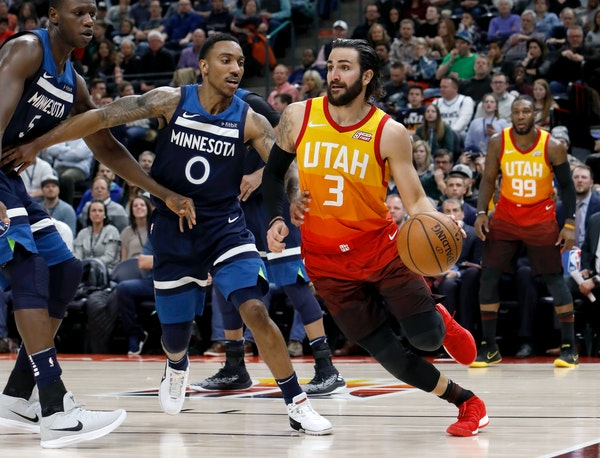 Utah Jazz's Ricky Rubio (3) drives the basket as Minnesota Timberwolves' Jeff Teague (0) defends in the second half of an NBA basketball game on Frida