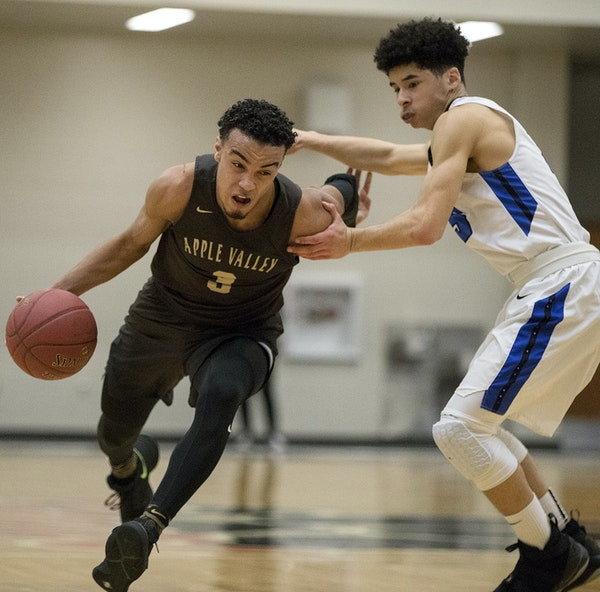 Apple Valley's Tre Jones tried to drive past Eastview's Izaak Raspberry during the first half of the Class 4A Section 3 Final.