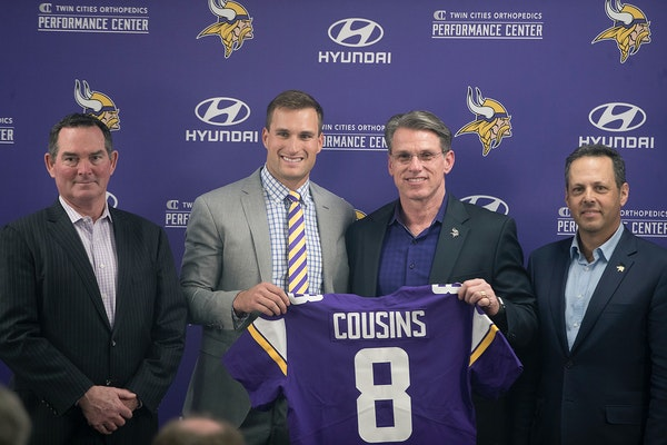 Vikings coach Mike Zimmer, left, stood next to Kirk Cousins, along with GM Rick Spielman and co-owner Mark Wilf on Thursday.