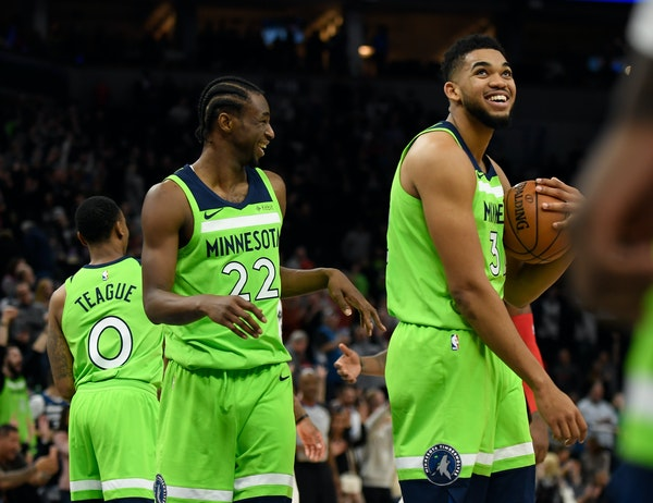 Karl-Anthony Towns, right, and Andrew Wiggins were smiling after a January win but it's more serious now.