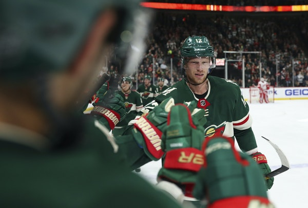 Wild center Eric Staal got congratulations from his teammates after scoring the tying goal in the second period Sunday night at Xcel Energy Center.