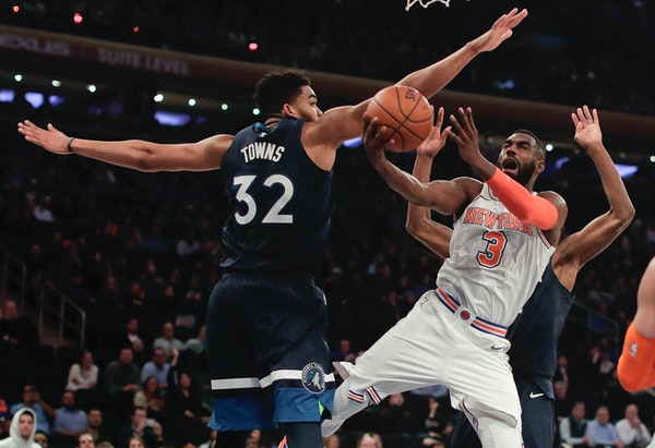 New York forward Tim Hardaway Jr. tried to shoot around Timberwolves center Karl-Anthony Towns in the fourth quarter Friday, when the Knicks had a har