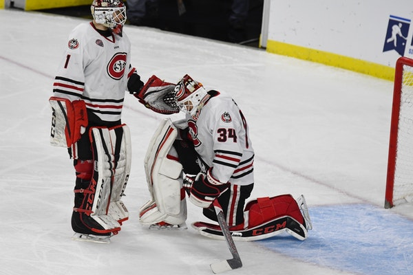 Jeff Smith (1) consoled fellow St. Cloud State goalie David Hrenak following Friday's 4-1 loss to Air Force in the NCAA men's hockey tournament in Sio
