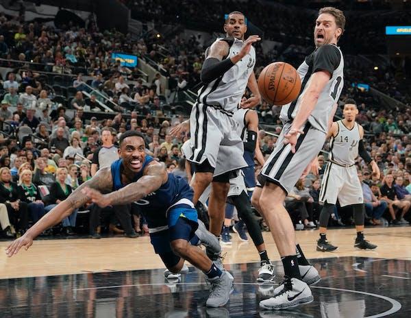 Minnesota Timberwolves' Jeff Teague, left, chases the ball as San Antonio Spurs' Pau Gasol, right, and LaMarcus Aldridge look on