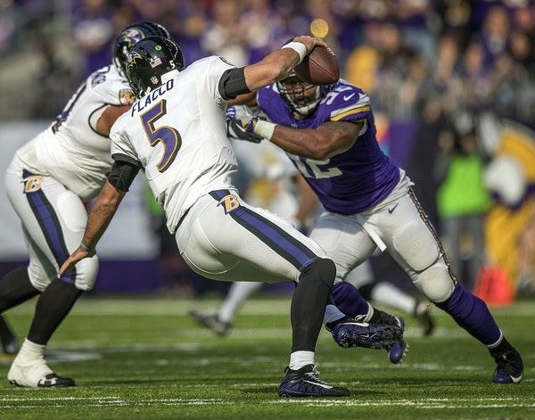 Vikings defensive tackle Tom Johnson closed in on Ravens quarterback Joe Flacco in October.