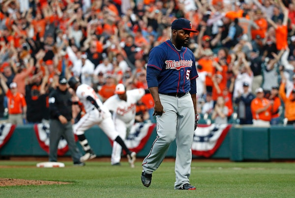 Twins reliever Fernando Rodney walked off the field after giving up a solo home run to the Orioles' Adam Jones in the 11th inning Thursday.
