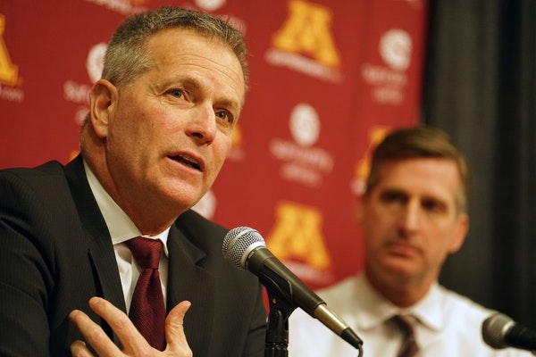 Don Lucia on Tuesday announced he is stepping down as Gophers men's hockey coach after 19 seasons. At right is U of M Athletics Director Mark Coyle.
