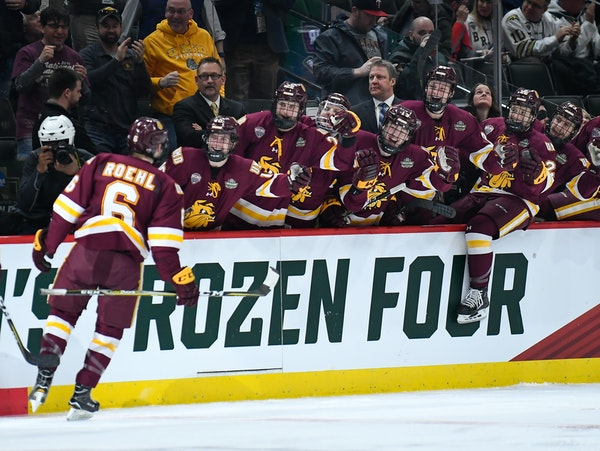 Teammates celebrated with Minnesota Duluth defenseman Louie Roehl after his first-period goal against Ohio State