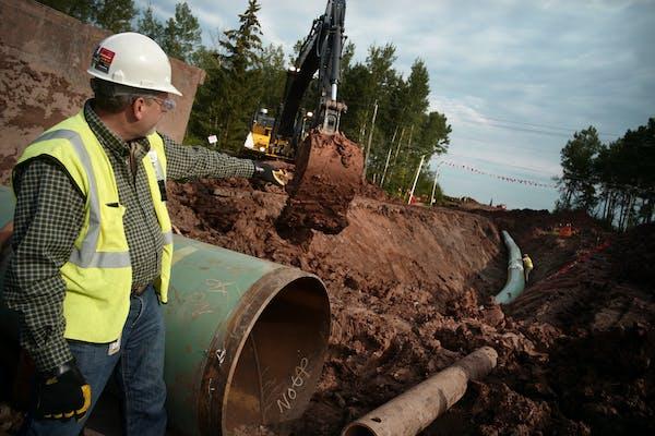 Workers instaled Enbridge's Line 3 replacement pipeline in Wisconsin.