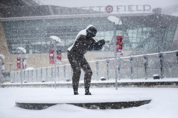 A statue of former Twin and multiple time All-Star Rod Carew is coated in fresh snow