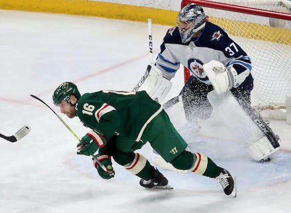 The Minnesota Wild's Jason Zucker (16) skates near Winnipeg goalie Connor Hellebuyck (37) during the Wild's 4-1 win over the Winnipeg Jets on Jan. 13,
