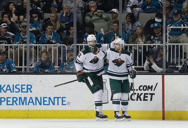 Wild left wing Jason Zucker, right, celebrates with Eric Staal after scoring a goal against the San Jose Sharks during the second period of Saturday's