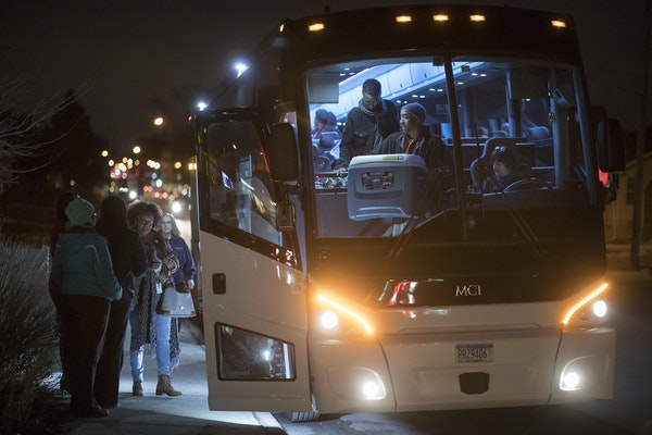 Parents said goodbye to students who gathered at the Northside Achievement Zone and board a bus for Washington on Wednesday to attend the March for Ou
