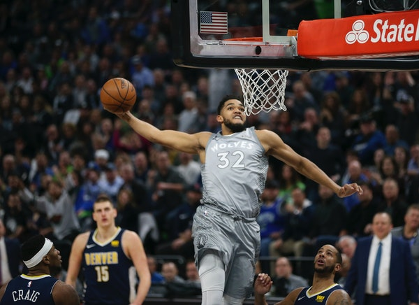 Timberwolves center Karl-Anthony Towns prepared to dunk in the first half.