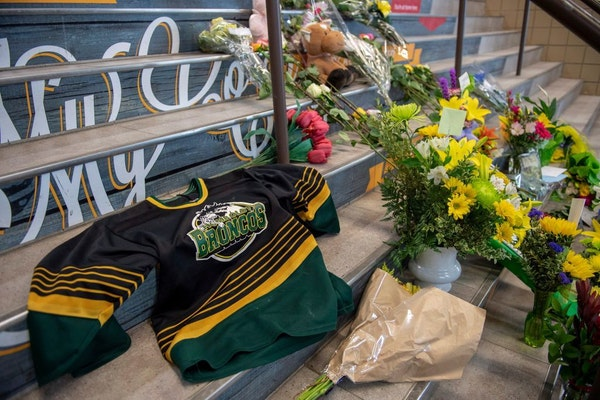 A memorial at the stairs that lead to Elgar Petersen Arena is shown in Humboldt, Saskatchewan, on SaturdayPolice say 15 people are dead and 15 injured