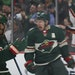 Minnesota Wild left wing Zach Parise (11) celebrated his first period goal with right wing Mikael Granlund (64).