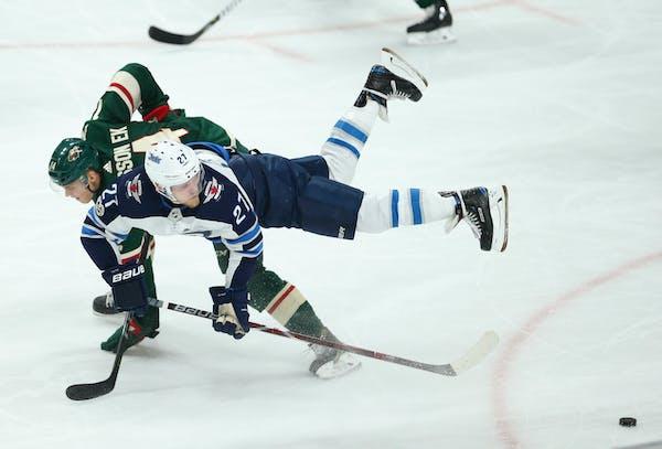 The Wild's Joel Eriksson Ek is upended by the Jets' Nikolaj Ehlers in October