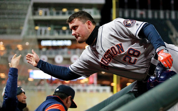 Houston Astros J.D. Davis (28) is congratulated by the dugout after hitting an RBI-single against the Minnesota Twins in the sixth inning of a basebal