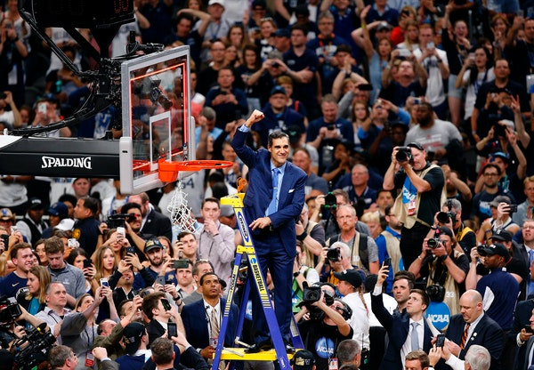 Villanova head coach Jay Wright reacts after cutting down the net after beating Michigan 79-62 in the championship game of the Final Four in San Anton