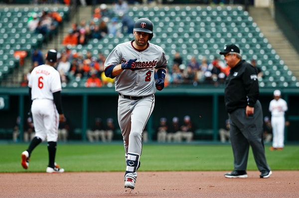 Minnesota Twins' Brian Dozier rounds the bases after hitting a solo home run in the first inning of a baseball game against the Baltimore Orioles, Sun
