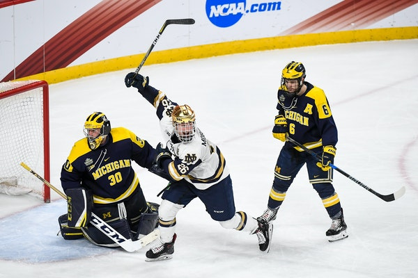 Notre Dame's Cam Morrison celebrates a goal by teammate Jake Evans, not pictured, against Michigan