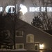 The lights from the signage on the side of the new Vikings practice facility in Eagan illuminate the homes on Lockwood Drive in Mendota Heights.